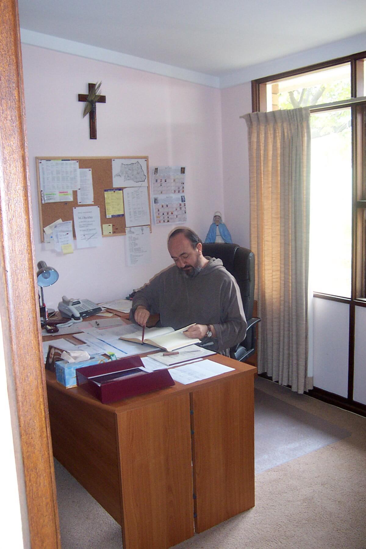 Fr C at desk